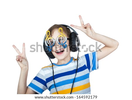 Beautiful stylish  child wearing big professional headphones and funny glasses posing and smiling  (music concept) - stock photo
