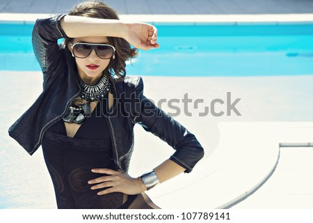 beautiful stylish girl in front of pool - stock photo