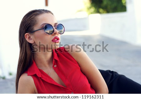 beautiful stylish girl in red blouse and sunglasses - stock photo