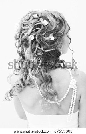 Beautiful stylish hairstyle with woven flowers - stock photo