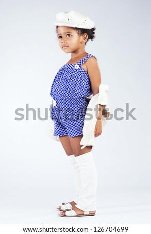 Beautiful stylish little girl - stock photo