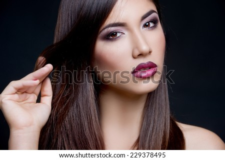 beautiful stylish young woman. Long hair  - stock photo