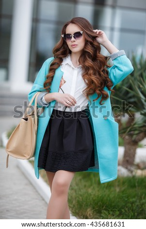 Beautiful stylish young woman on street. lifestyle fashion portrait of young stylish woman walking on street, wearing cute trendy outfit and sunglasses