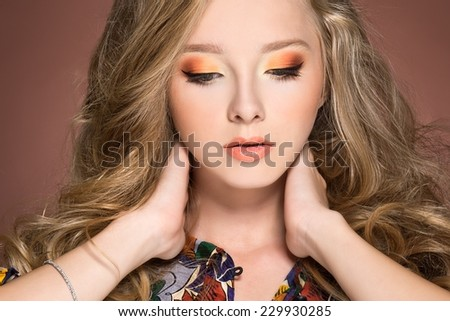 beautiful stylish young woman with coloful make up  - stock photo