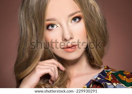 beautiful stylish young woman with coloful make up  - stock photo