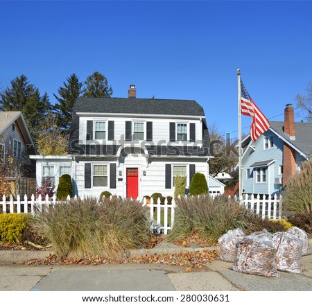 Beautiful Suburban Home Clear Blue Sky Autumn Day White Picket Fence residential neighborhood USA - stock photo