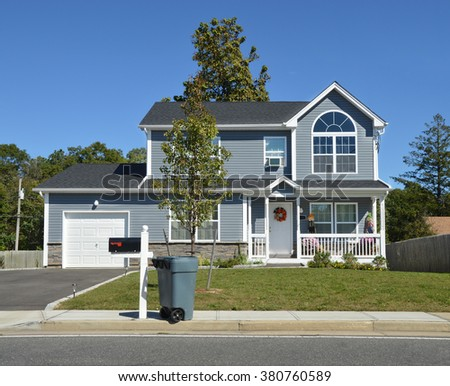 Beautiful Suburban Home Curbside Mailbox Trash Container, Clear Blue Sky Day Sunny Residential Neighborhood USA