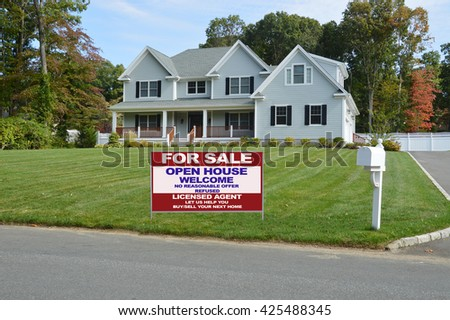 Beautiful Suburban McMansion style home Residential Neighborhood Sunny Blue Sky USA - stock photo