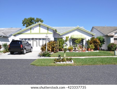 Beautiful Suburban Ranch Home Residential Neighborhood Clear Blue Sky Sunny USA