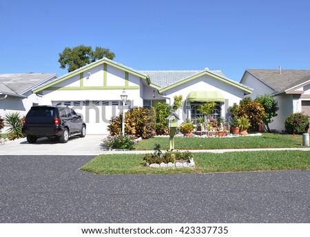 Beautiful Suburban Ranch Home Residential Neighborhood Clear Blue Sky Sunny USA - stock photo