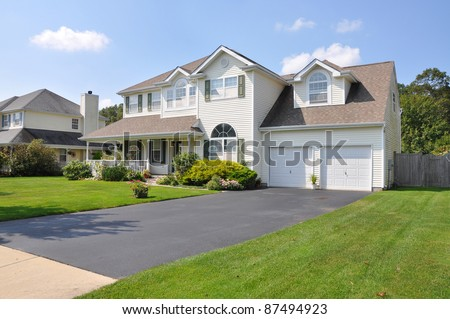 Beautiful Suburban Split Level McMansion Home Two Car Garage in Residential Neighborhood - stock photo