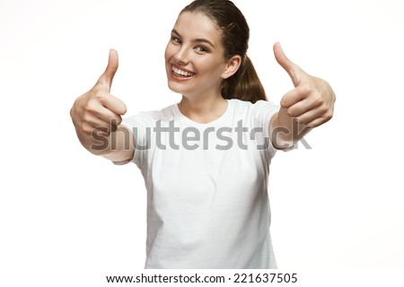Beautiful success young woman giving thumbs up / Gorgeous girl in plain white T-shirt. Mixed race Latina Caucasian young woman gesticulating - isolated on white background.  - stock photo