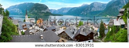 Beautiful summer Alpine Hallstatt Town and lake Hallstatter See view (Austria, view from underground tunnel parking). Three shots stitch image. - stock photo