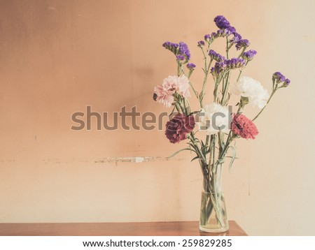 Beautiful summer flowers in vases on wooden background - stock photo