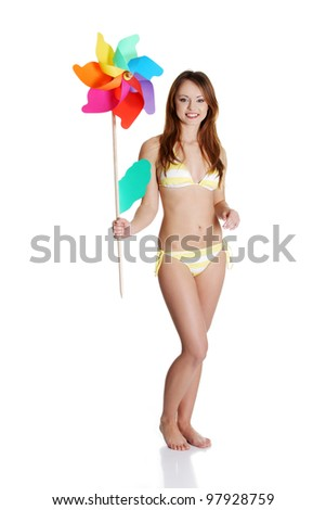 Beautiful summer girl with windmill, isolated on white - stock photo