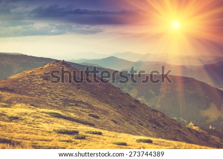 Beautiful summer landscape in the mountains at sunshine.Filtered image:cross processed vintage effect.  - stock photo