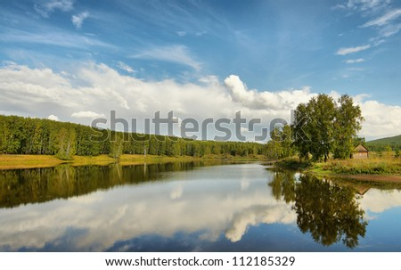 Beautiful summer landscape on the lake - stock photo