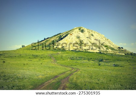 Beautiful summer landscape, way to the high mountain, tinted image - stock photo
