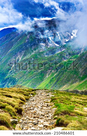 Beautiful summer landscape with Fagaras mountains in Romania - stock photo