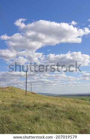 Beautiful summer landscape with power line