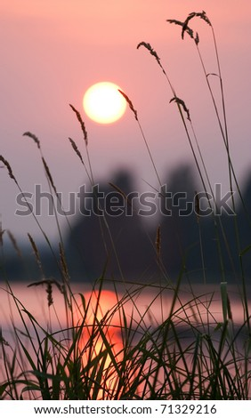 Beautiful summer landscape with the river on a sunset - stock photo
