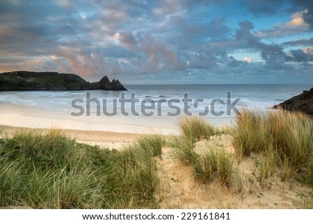 Beautiful Summer morning landscape over yellow sandy beach - stock photo