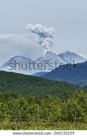 Beautiful summer mountain landscape of Kamchatka Peninsula: eruption active Zhupanovsky Volcano. Russia, Far East. - stock photo