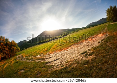 Beautiful summer night in Crimea. Full Moon. Trees, fields and mountains - stock photo