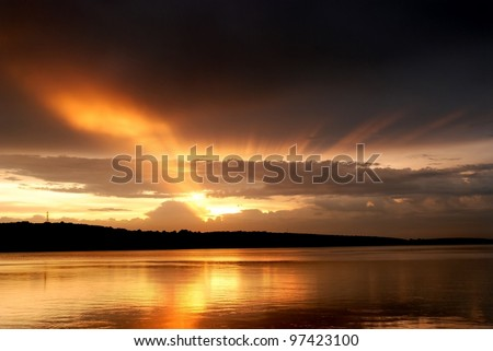 Beautiful summer sunset in the lake. - stock photo