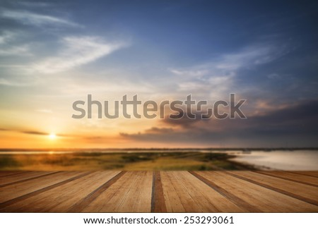 Beautiful Summer sunset landscape over wetlands and harbor with wooden planks floor - stock photo