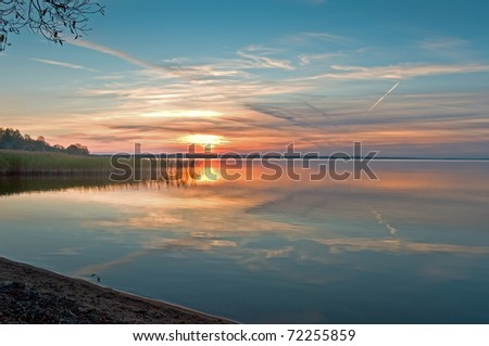 Beautiful summer sunset on lake - stock photo