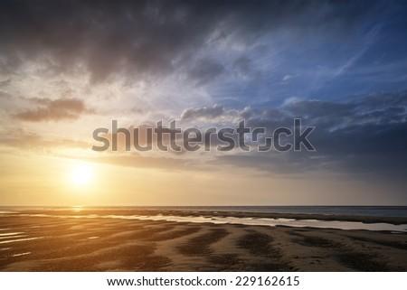 Beautiful Summer sunset over golden beach landscape - stock photo