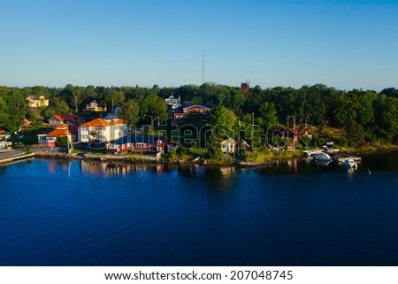 Beautiful summer vibrant picture of Stockholm archipelago and skerries with a cottages and boats - stock photo