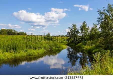 Beautiful summer water landscape in sunbeam. Evening. - stock photo
