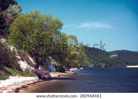 Beautiful summer water landscape in the sunbeam. - stock photo
