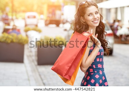 beautiful summer woman goes shopping in the city - stock photo
