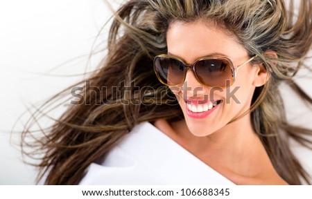 Beautiful summer woman smiling and wearing sunglasses - stock photo