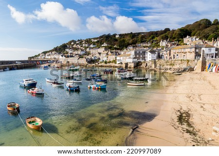 Beautiful summers day at Mousehole Harbour near Penzance Cornwall England UK Europe - stock photo