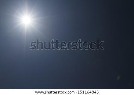 beautiful sun flare in sky - stock photo