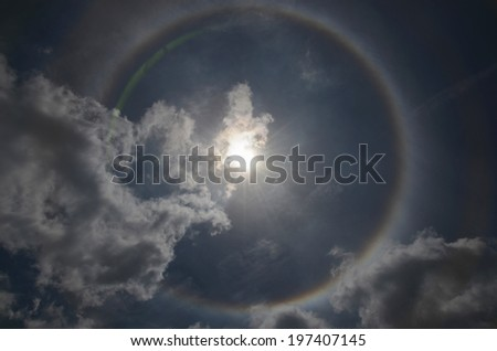 Beautiful sun halo with the blue sky and cloud - stock photo