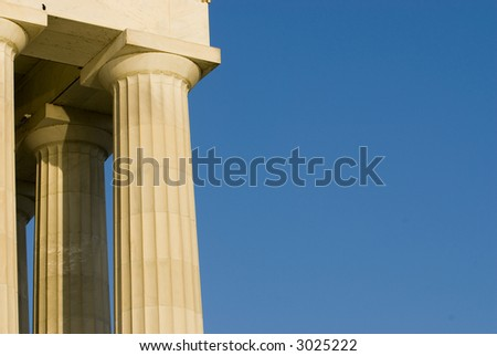 Beautiful sun lit building columns background texture with blue sky 01