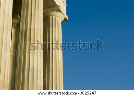 Beautiful sun lit building columns background texture with blue sky 06