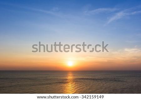 Beautiful sun rise at beach. - stock photo