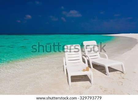 beautiful sunbed blue sun sea tropical nature background holiday luxury  resort island atoll about coral reef