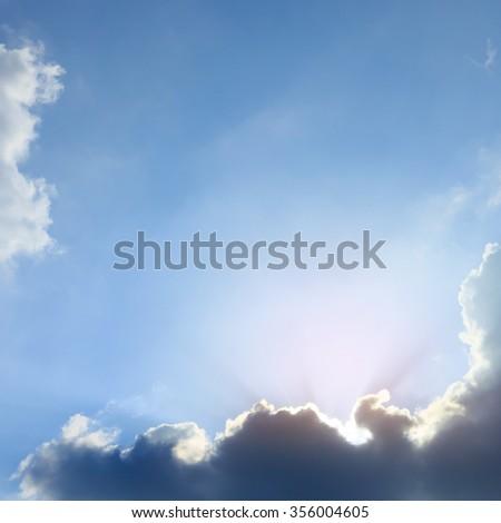 beautiful sunlight of sunbeams, light rays on dramatic sunset sky background - stock photo