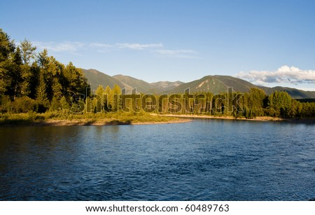 Beautiful sunny afternoon on the North Fork River near Glacier National Park in Montana. - stock photo