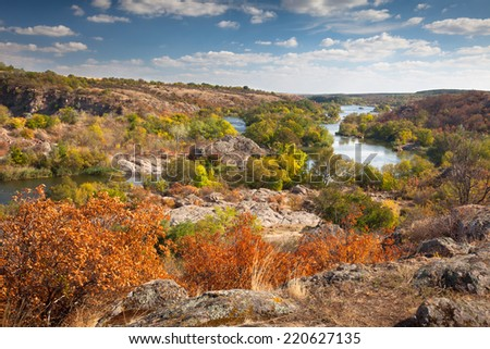 Beautiful Sunny Autumn Day  - Panoramic view on the river, colorful trees  and big rocks - wallpaper - stock photo