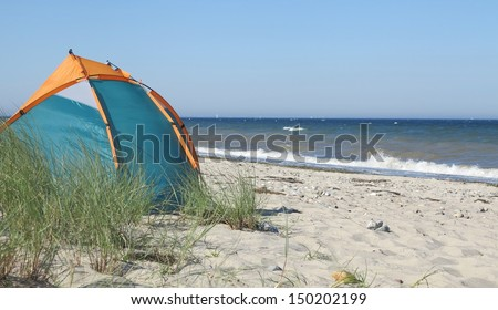 beautiful sunny day at the beach and beach tent - stock photo