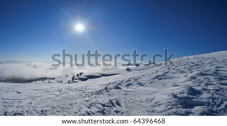 Beautiful sunny day in the snowy mountains - stock photo