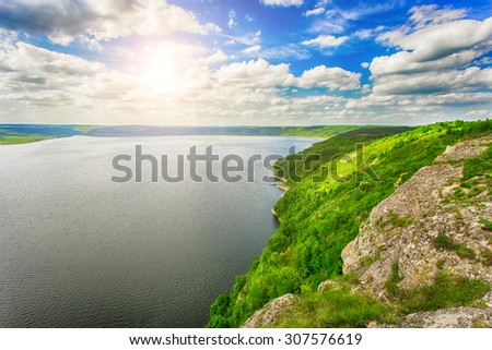 Beautiful sunny day on the coast of the river - stock photo